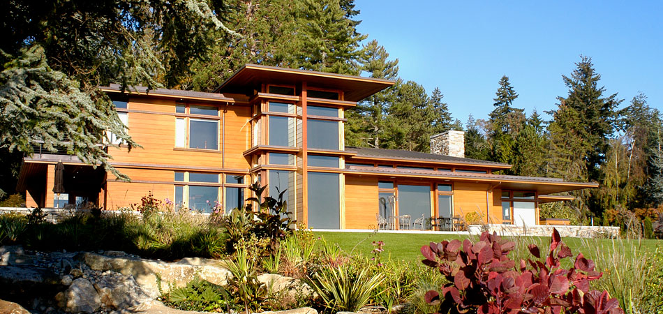 This home on Bainbridge Island's Point White waterfront is recognized as a classic example of contemporary residential Northwest architecture. Tucked away from a busy road, the house design reveals itself in stages…